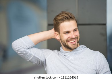Man confident in his antiperspirant. Prevent, reduce perspiration. No sweat - deodorant works. Guy checks dry armpit satisfied with clean clothes. Sportsman after training pleased with antiperspirant.