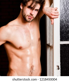 Man confident lover near door. Sexy attractive macho tousled hair coming out through bedroom door. Sexy bachelor lover concept. Guy attractive lover posing seductive. Seductive lover full of desire.