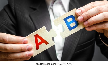 A man connects puzzles with the letters A and B. A/B test marketing research method. multivariate testing. Improving products and services based on statistics and observations. Marketer
