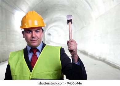 man with construction hat portrait and a hammer