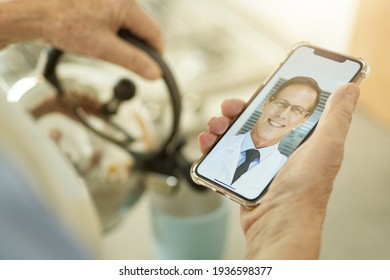 Man contacting his medical doctor on the video-call