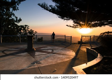 A man contemplating the sunrise in Picnic Point, Toowoomba, Queensland.