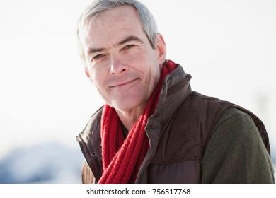 Man contentedly smiling