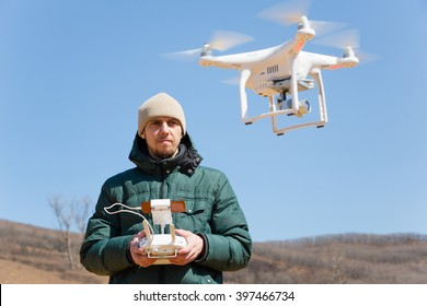 Man controls the flying drones spring