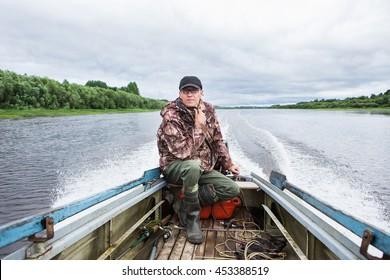 man controls the motor boat