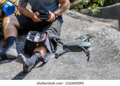 man controls quadrocopter, close-up
