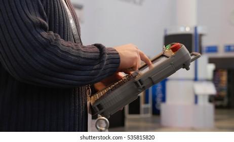 Man controls to robotics arm for technowelding on industry