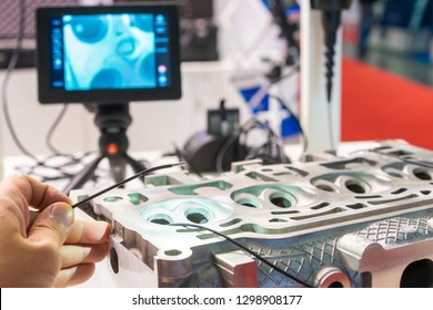 A man controls a video endoscope. Quality control of metal welding. Check weld. Video endoscope. Investigated pipes with a video endoscope. Supervision of production.