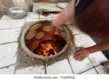 Man cooking arabic bread. Kashgar , Chinese Xinjiang province
