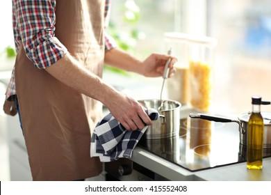 Man cooking dinner in bright kitchen