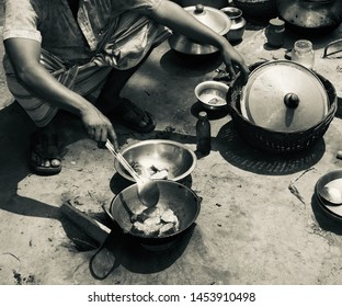 Man cooking food sitting in a place unique photo