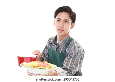 A man cooking healthy food