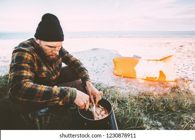 Man cooking outdoor pancakes breakfast travel lifestyle vacations camping kitchen on beach weekend journey