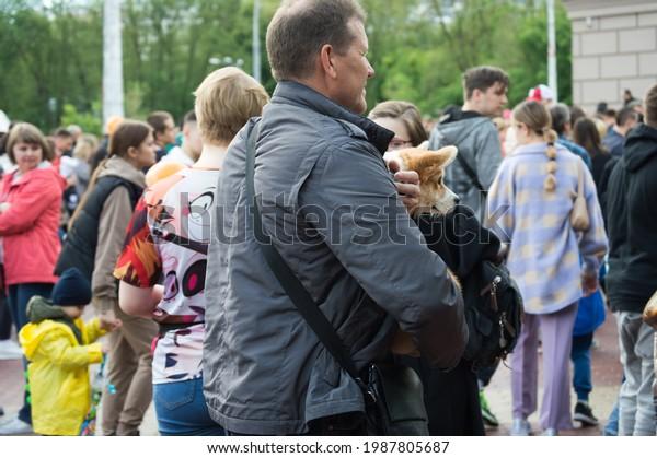 man-corgi-dog-his-arms-600w-1987805687.j