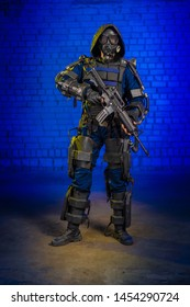 man cosplayer in a suit heavy infantry storm trooper in power armor on a blue background