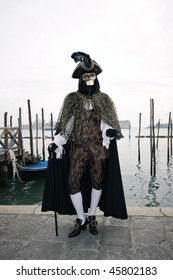 Man with costume medioval and black capote to Carnival of Venice
