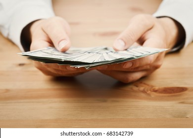 Man count money cash in his hand. Finance, saving, salary and donate concept.