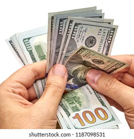 Man count the new us dollars or money. New design US Dollar bills bundle counting with hand isolated on white background including clipping path.