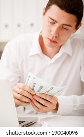 man counting money in office