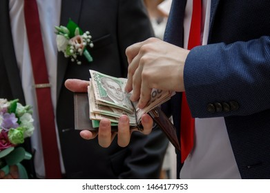 A man counts money. Banknotes in the wallet. Men's hands count the hryvnia. A man takes out the hryvnia money from the wallet