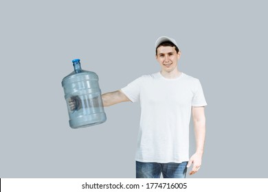 man courier holding water bottle holds in his hand