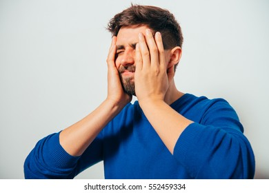 man covered his face with his hands