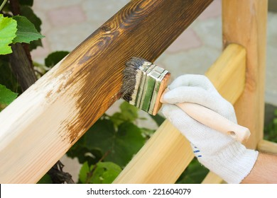 man covered with lacquer wooden fence