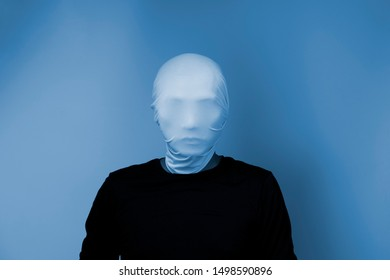Man covering his face with white mask