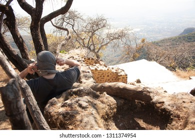 Man covering his head with a bandana at the bottom of a pyramid dating from 1153 buried in the chasm of the great hill of the speaker in a state of Mexico