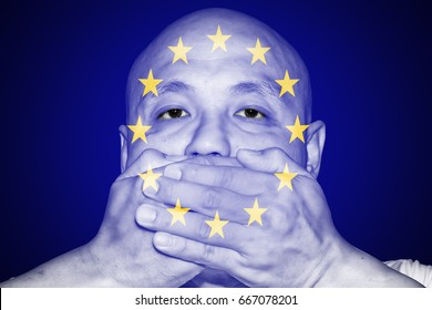 A man covering his mouth with his hand with imprint of the European Union Stars for the concept: Freedom of Speech in Europe.