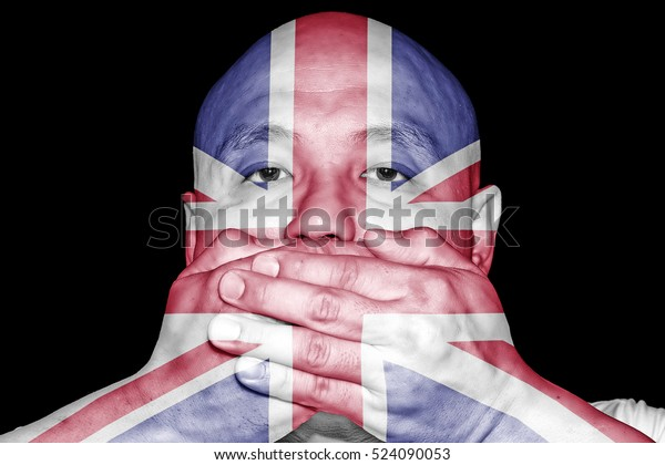 A man covering his mouth with his hand with imprint of the British Union Jack flag for the concept: Freedom of Speech in the United Kingdom.