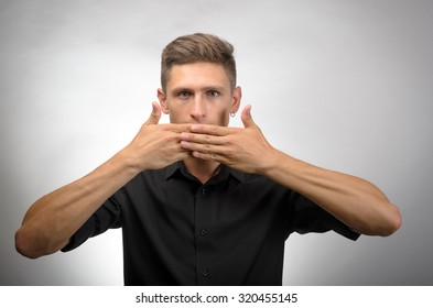 man covering his mouth with hands. i shouldn't have said that