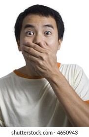 a man covering his mouth and looking very shocked