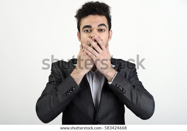Man covering mouth and not speaking