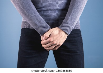 man covers groin, health problems
