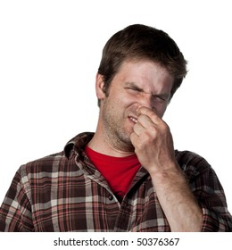 Man covers his nose due to a bad smell