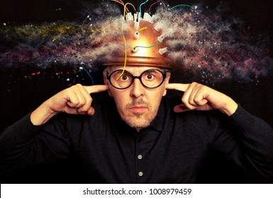 Man crazy inventor wearing a helmet brain research. Brainstorm