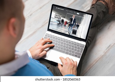 Man creating website for his business by using laptop computer