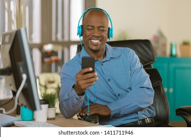 Man in a creative office listening to music or other media