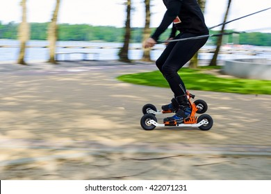 Man cross-country skiing with roller ski - motion blur
