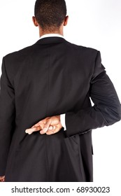 Man with crossed fingers behind his back