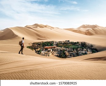 Man crossing the desert finds oasis