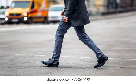 a man crossing the road