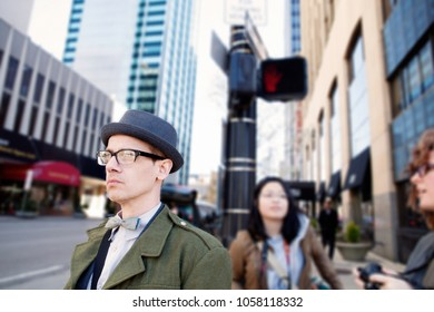 Man at Crosswalk on City Street Corner