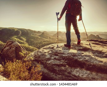 Man with crutches and strong will. Disabled tourist successfully climb  in park. Hiker man is celebrate alone attachment of his target.