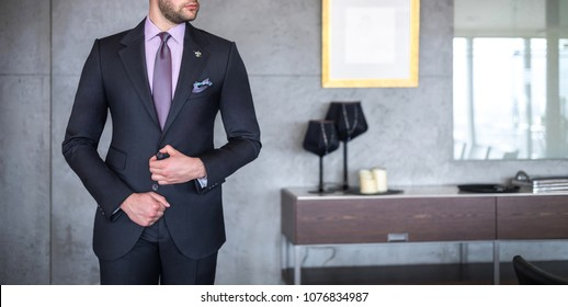 Man in custom tailored business suit posing indoors