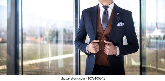 Man in custom tailored suit posing indoors