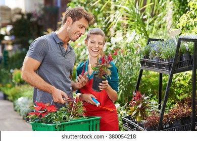 Man as customer in garden center talking with gardener