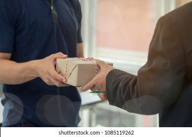 man customer hand accepting receiving a package  from a deliveryman .postal and delivery package through a service,courier service concept,