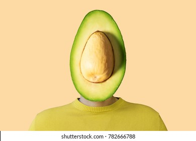 A man with a cut avocado instead of head. Minimal concept.